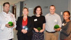 From left, staff recipient David Johnson, faculty recipient Danesha Seth Carley, student recipient Hannah Frank, and University Student Center representatives TJ Willis and Alyson Lee. Winners receive plaques made from recycled glass.