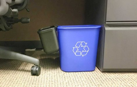 Mini landfill bins clip onto a full-size, deskside recycling bin. At University of North Carolina at Charlotte, use of mini-bins have increased recycling by 15 percent and save $13,000 annually by not needing to purchase plastic liners for waste bins.