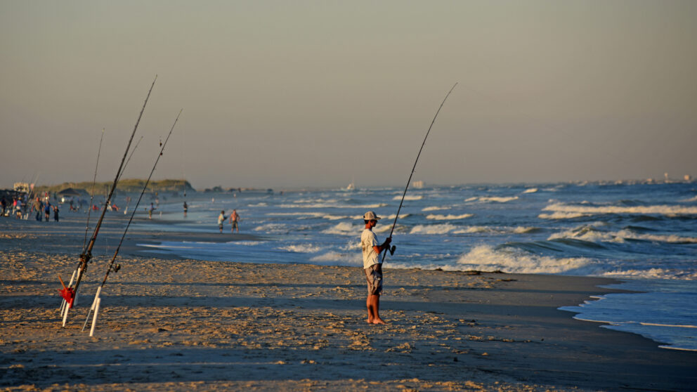 Fisherman tries his luck along the surf at Carolina Beach's Freeman Park.