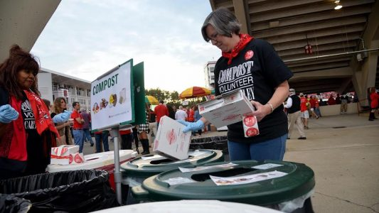 Carter-Finley Composts volunteers assist fans in sorting waste into composting, recycling or landfill bins.